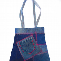 Upcycled denim shoulder bag with lots of red topstitching
