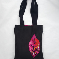 Black faux suede tote bag with multi coloured leaf appliqué