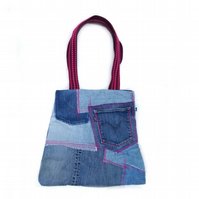 Upcycled denim patchwork bag with pink topstitching