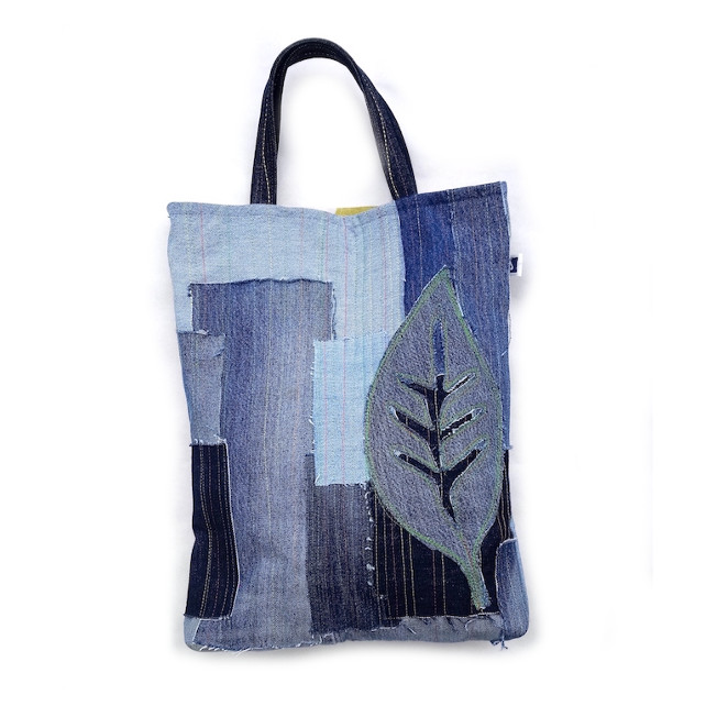 Denim patchwork tote bag with leaf appliqué