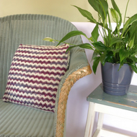 Hand-knitted cream and purple cushion cover