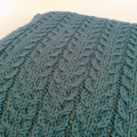 Hand-knitted blue cable cushion cover
