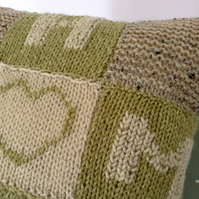 Small decorative hand-knitted cushion cover