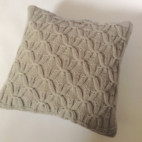 Geometric patterned hand-knitted cushion cover