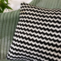 Hand-knitted black and white patterned cushion cover