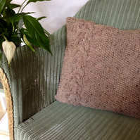 Hand-knitted chunky cable cushion cover