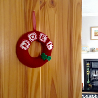 Simple wool Christmas wreath with knitted holly decoration