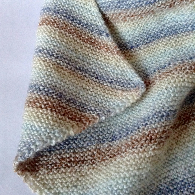 Diagonal striped hand-knitted baby blanket