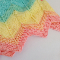 Rainbow striped hand-knitted baby blanket