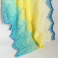 Blue and yellow hand-knitted baby blanket