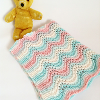 Wavy striped hand-knitted baby blanket