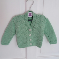 Hand-knitted baby cardigan in mint green