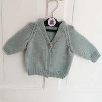 Hand-knitted baby cardigan in pale blue