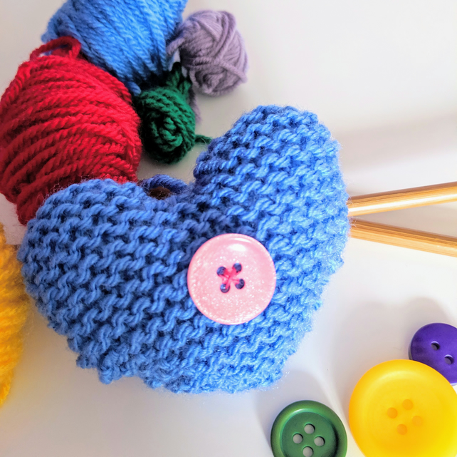Hand-knitted pastel blue button heart
