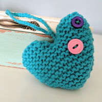 Hand-knitted teal button heart