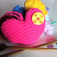 Hand-knitted neon pink button heart