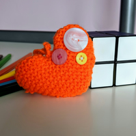 Hand-knitted neon orange button heart