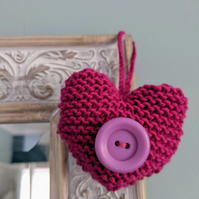 Hand-knitted magenta button heart