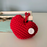 Hand-knitted red button heart