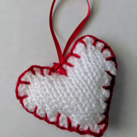 Hand-knitted red and white love heart