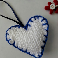 Hand-knitted blue and white love heart