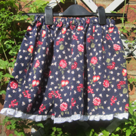 Navy flowered skirt with white broderie anglaise trim