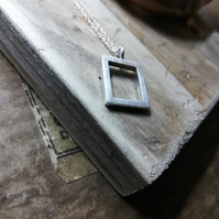 Rectangular silver pendant on silver chain by wocky metals. Handmade frame