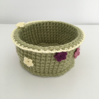 Crochet green round basket with flowers for storage