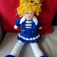 Hand knitted soft doll