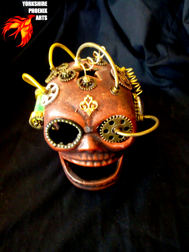 Steampunk skull with gears, cabling and green light
