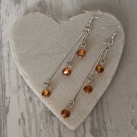 Long Amber Coloured Sparkly Faceted Crystal Drop Earrings