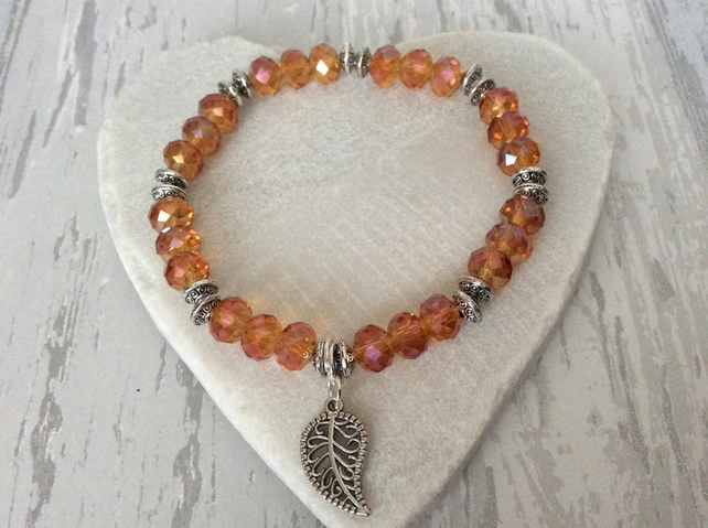 Sparkly Amber Coloured Faceted Aurora Crystal Bead Bracelet with Leaf Charm