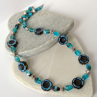 Denim Blue & Black Hawaiian Flower Necklace with Turquoise Oval Twist Beads.