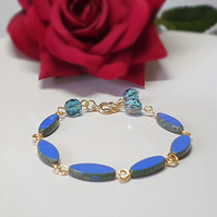 Royal blue and gold oval beaded bracelet