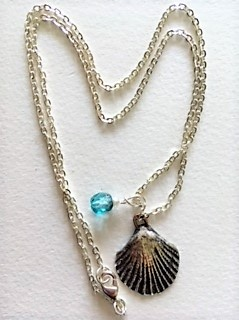 Fine silver scallop shell and blue cut glass bead necklace
