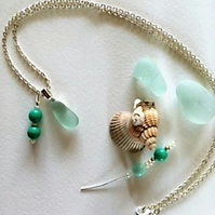 Seafoam sea glass pendant with sea green glass bead charm