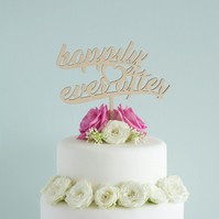 Wedding cake decoration. Cursive script 'Happily ever after' lettering L49