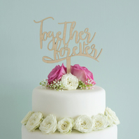 Script lettering 'Together forever' wedding cake topper. Unique cake decoration