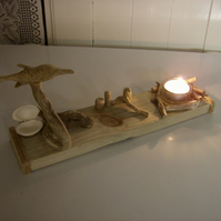 handmade welsh driftwood and pine dolphin tea light, with candles