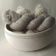 Cotton Rope Storage Bowl, a coiled rope basket with soft green detail