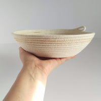 Freshwater Bay Bowl, a coiled rope bowl with ochre stitched detail