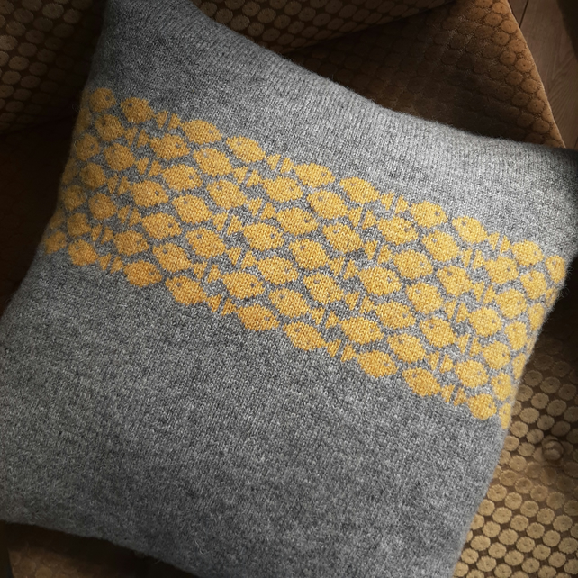 Grey Knitted Cushion with yellow fish detail