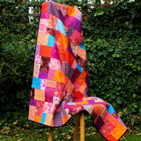 Orange and purple handmade patchwork quilt, made in Manchester bright quilt