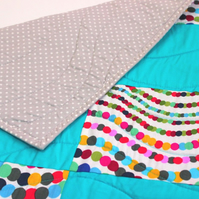 Bright turquoise bubbles play mat, children's patchwork quilt, tummy time mat