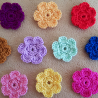 Set of 10 multicoloured hand crocheted daisy flowers in red, pink, purple, green