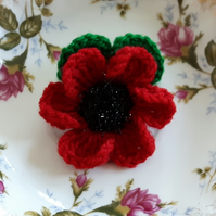 Crocheted poppy flower brooch with leaves for your coat, hat or bag