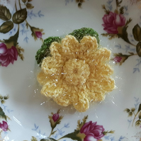 Hand crocheted sparkle yellow daisy brooch with leaves for your coat, hat or bag