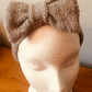 Dolly Bow knitted deep beige colour headband