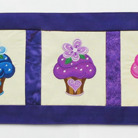 Purple cupcake themed table runner.