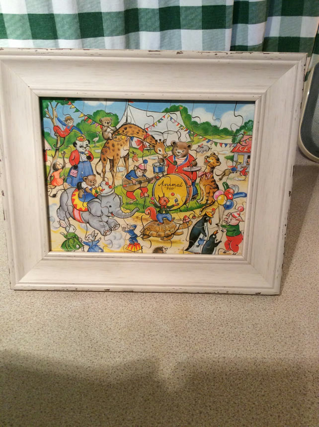 Framed puzzle of animal band